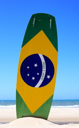 brazilian flag painted on a kite surf board with praia e vento (beach and wind) instead of ordem e progresso  in prainha beach near fortaleza photo