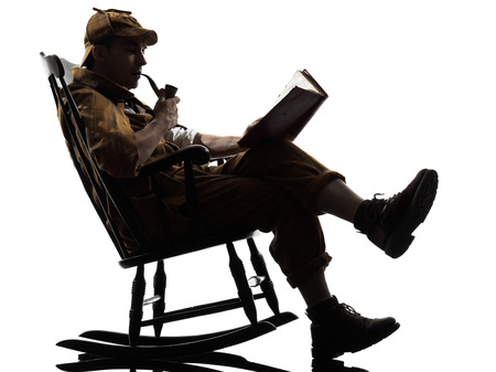 'rocking chair': sherlock holmes reading silhouette sitting in rocking chair in studio on white background