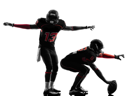 quarterback: two american football players on scrimmage in silhouette shadow  white background