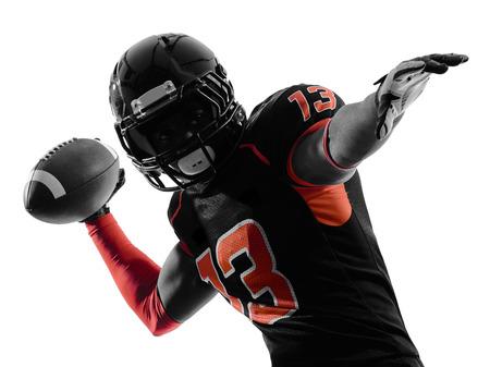 jugador de futbol americano: uno de los jugadores del f�tbol americano que pasa retrato en silueta sombra sobre fondo blanco Foto de archivo