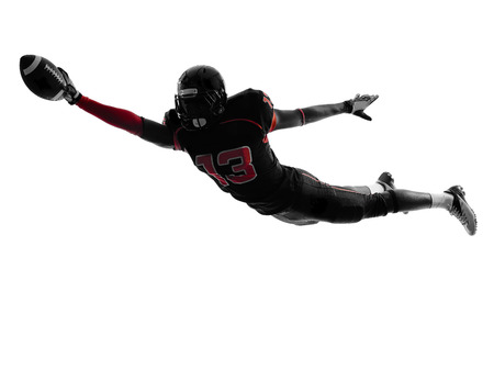 scoring: one  american football player scoring touchdown in silhouette shadow on white background Stock Photo