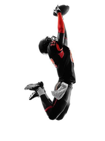 coger: un jugador de f�tbol americano Bola de cogida en sombra de la silueta en el fondo blanco