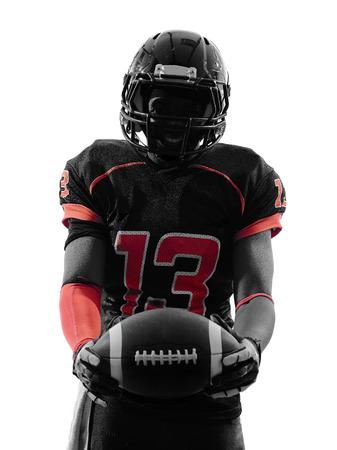 football silhouette: un giocatore di football americano in piedi tenendo palla in silhouette ombra su sfondo bianco Archivio Fotografico