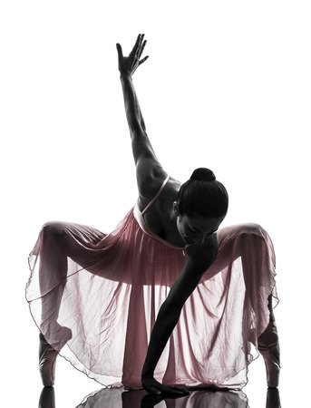 crouches: one  woman   ballerina ballet dancer dancing in silhouette on white background