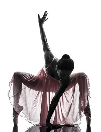 bailarina de ballet: una mujer, bailarina de ballet, bailar�n, bailando en la silueta en el fondo blanco Foto de archivo