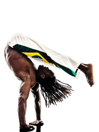 one brazilian  black man dancer dancing capoeira on white background photo