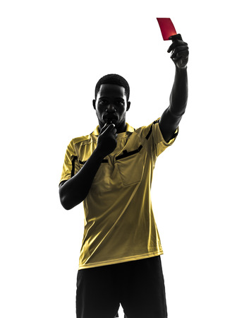 referee: one african man referee showing red card  in silhouette  on white background