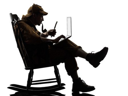 investigating: private investigator with computer laptop silhouette sitting in rocking chair in studio on white background