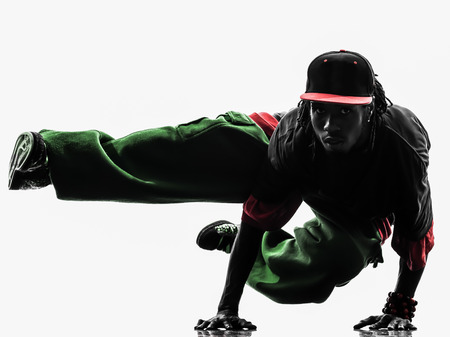 hip hop man: one hip hop acrobatic break dancer breakdancing young man handstand silhouette white background Stock Photo