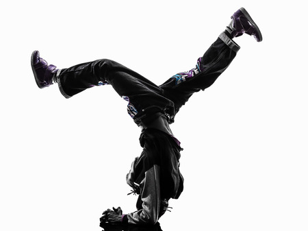 acrobatic: one hip hop acrobatic break dancer breakdancing young man handstand silhouette white background Stock Photo
