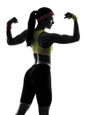one  woman exercising fitness flexing muscles  rear view in silhouette  on white background Imagens