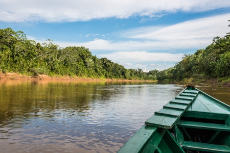 peru amazon: boat in the river in the peruvian Amazonian jungle at Madre de Dios