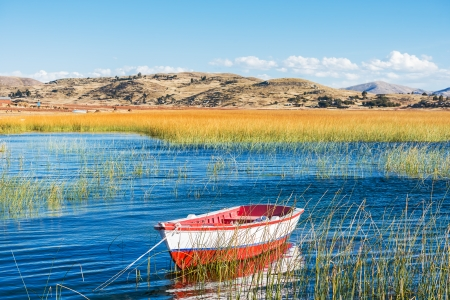boat in Titicaca Lake in the peruvian Andes at Puno Peru photo