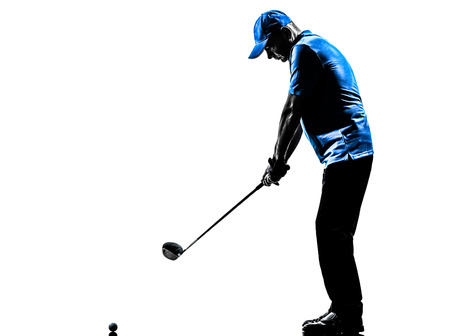 one man: one man golfer golfing golf swing in silhouette studio isolated on white background