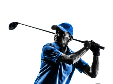 playing golf: one man golfer golfing in silhouette studio isolated on white background Stock Photo