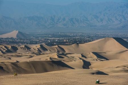 peru: tourists with dune buggies in the peruvian coast at Ica Peru