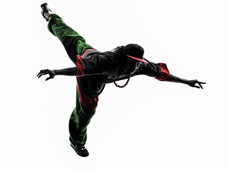 acrobatic: one hip hop acrobatic break dancer breakdancing young man jumping silhouette white background