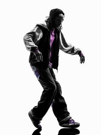 dancer silhouette: one hip hop acrobatic break dancer breakdancing young man moonwalking silhouette white background Stock Photo