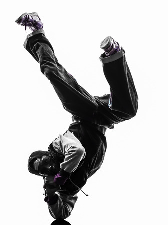 hip hop dancing: one hip hop acrobatic break dancer breakdancing young man handstand silhouette white background Stock Photo