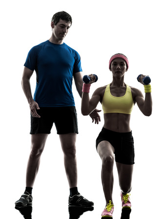 one  woman exercising fitness weight training with man coach in silhouette  on white background photo