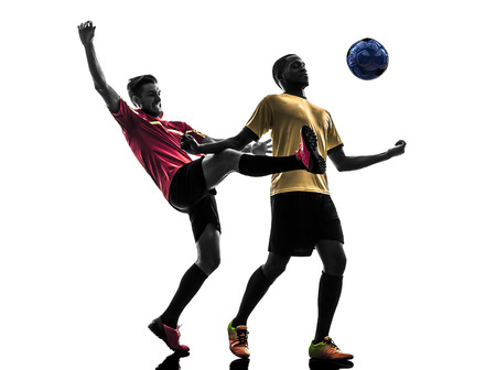 two men soccer player playing football competition in silhouette  on white background photo