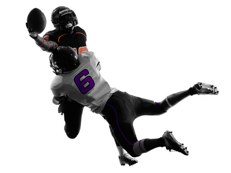 american football background: two american football players tackle  in silhouette shadow on white background Stock Photo