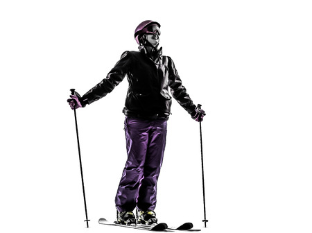 one caucasian woman skier skiing happy smiling  in silhouette on white background photo