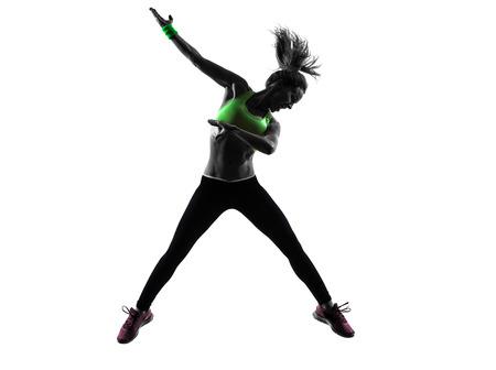 한 백인 여자는 흰색 배경에 실루엣 피트니스 ZUMBA 춤 점프 운동 스톡 콘텐츠