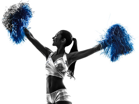 one young woman cheerleader cheerleading  silhouette studio on white background photo
