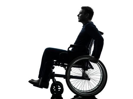 wheelchair man: one handicapped man side view serious in silhouette studio  on white background Stock Photo