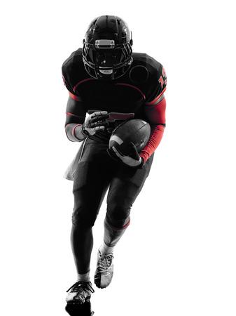 uniforme de futbol: un jugador de fútbol americano en el running silueta sombra sobre fondo blanco