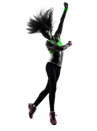zumba: one caucasian woman exercising fitness zumba dancing jumping in silhouette  on white background Stock Photo