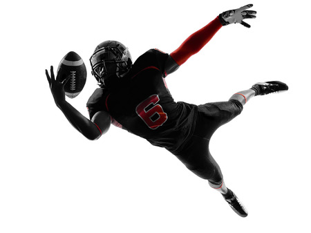 football american: one american football player catching ball  in silhouette shadow on white
