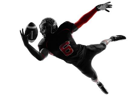 shadows: un jugador de f�tbol americano Bola de cogida en la silueta de la sombra en blanco