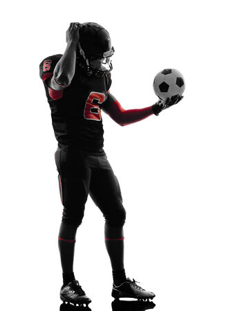 one american football player soccer ball confused in silhouette shadow on white  photo