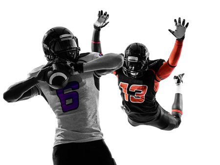 tackle: two american football players quarterback sacked in silhouette shadow on white background