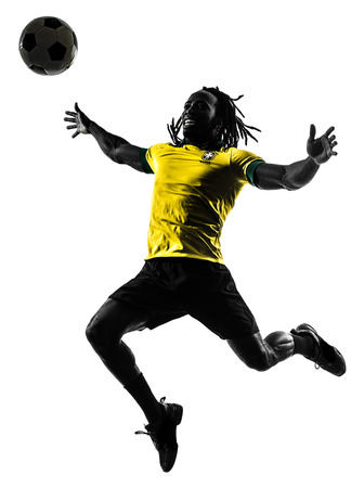 one black brazilian soccer football player man in silhouette studio on white background photo