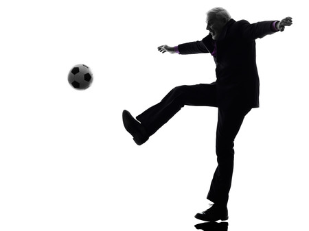 One Caucasian Senior Business Man playing soccer Silhouette White Background photo