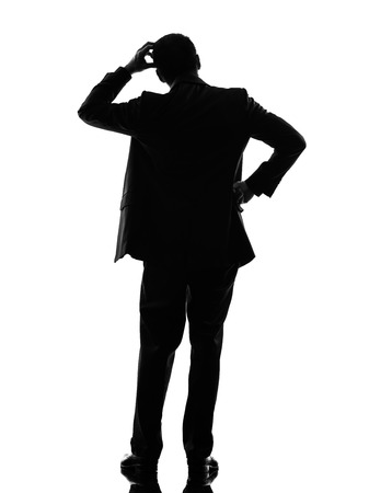 one caucasian business man thinking rear view back in silhouette  on white background photo