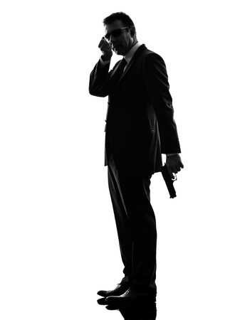 one secret service security bodyguard agent  man in silhouette  on white background photo