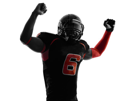 american football background: one american football player arms raised portrait in silhouette shadow on white background Stock Photo