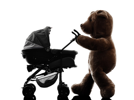 one teddy bear prams baby walking silhouette on white  photo