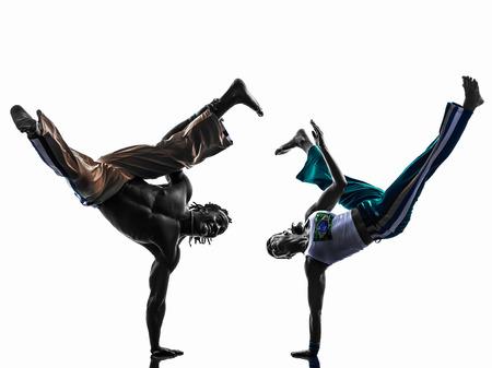 二人 capoiera ダンサーの白い背景で隔離のシルエット スタジオで踊るカップルします。 写真素材