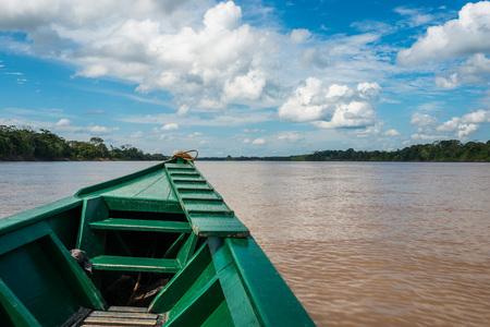 peru amazon: boat in the river in the peruvian Amazon jungle at Madre de Dios Peru Stock Photo