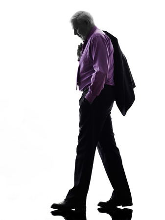 One Caucasian Senior Business Man walking sadness Silhouette White Background photo