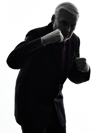 One Caucasian Senior Business Man punching the air Silhouette White Background photo