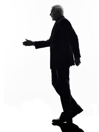 One Caucasian Senior Business Man walking handshake Silhouette White Background photo