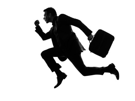 one caucasian business man running in silhouette  on white background photo