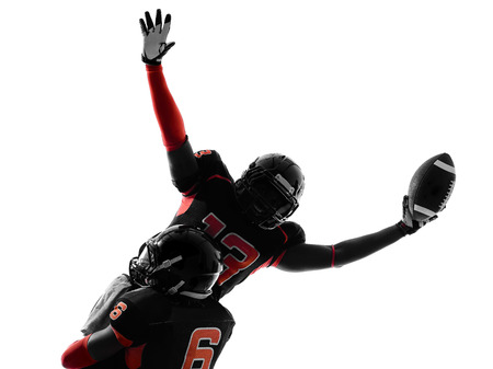 touchdown: one american football player touchdown celebration in silhouette shadow on white background