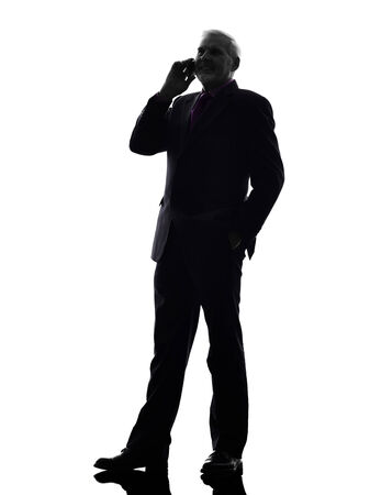 senior business man: One Caucasian Senior Business Man on the telephone smiling Silhouette White Background